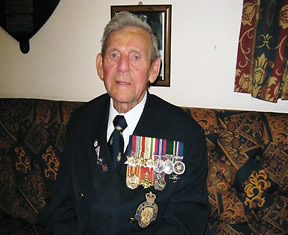 Ken Blake with his medals